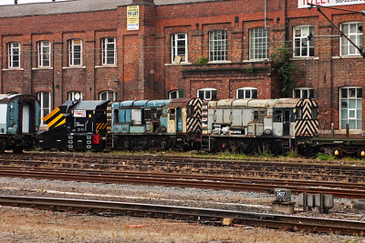 Two more withdrawn shunters sit beside the offices which are now To Let. 08819 and the unidentified classmate have what looks like ex-works independent snowplough ADB965233 keeping them company.