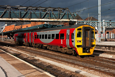 Dark clouds gather to the north east but the sun shines down on 158905 in its attractive Metro livery as it departs Doncaster with 1J29 1326 Scarborough to Sheffield.