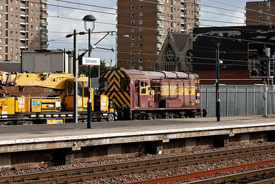 Another look at 08514 as it rumbles through platform 1 with its train of cranes.