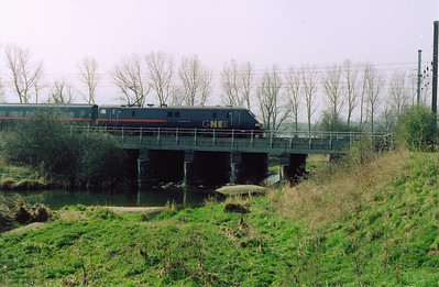 Seen from the east side of the line at Lolham Level Crossing and 91107 crosses over the River Welland with 1D29 1033 Kings Cross to Leeds service.