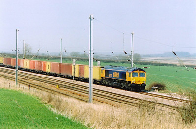 A GBRf working heads south with 66717 in charge of 4L78 1141 Selby to Felixstowe Intermodal service. A private halt once stood here.