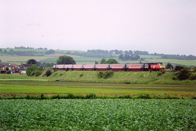 The empty stock working from Craigentinny to Dundee follows the sleeper by about 5 or so minutes. The powercars are 43121 and 43198.  27/6/2000