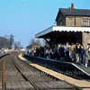 A sight never to be seen again. A packed Up platform at Histon with passengers awaiting a Railway Development Society special from Swavesey to Liverpool Street.  12th April 1980