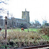 A fine view of Swavesey Parish Church, but the photo also shows the token delivery apparatus ie the post on the left which was used to deliver the token in a pouch to the driver for the single line section between Swavesey and St Ives.  9th December 1978