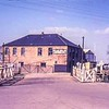 Chatteris station gates c1960. The station is to the immediate right as is the concrete lattice Up starter signal. <br /> <br /> Image:- Thanks to Brian Hemment.
