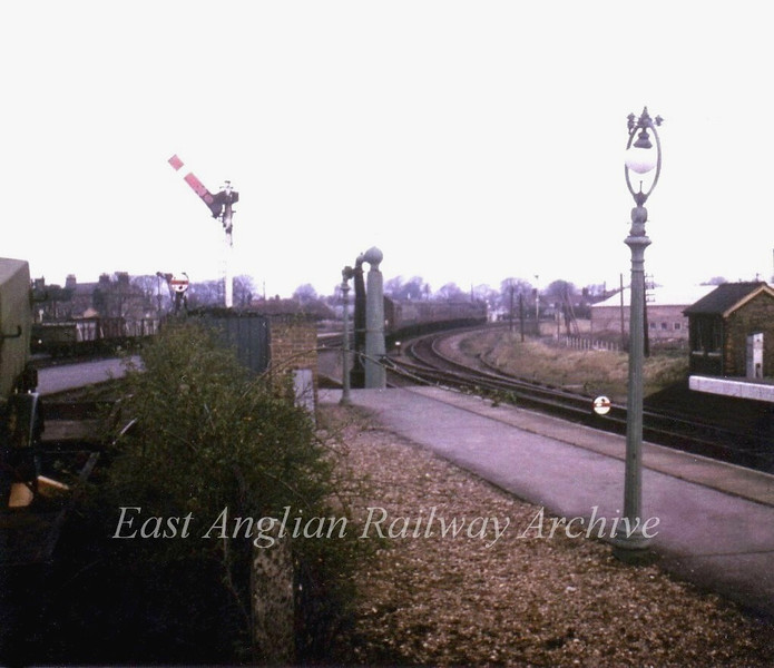 The same view as the last photo ie the end of the platform at St Ives this time on 4th March 1967, the last day of traffic through to March.  Class 31 D5637 rounds the curve away from the station towards Somersham. The goods yard to the left still has wagons in it.  Photo with kind permission of Stewart Ingram