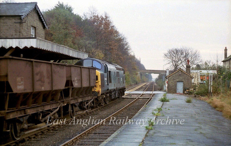 37099 heads towards Cambridge in this scene on 23rd November 1979. The crossing keepers hut at least has been saved from the destruction caused by the guided busway. Local volunteers  took it down brick by brick and rebuilt it the other side of the tracks.