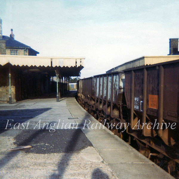St Ives through platforms on 2nd February 1974 which at the time were used for storing sand wagons for Fen Drayton. View towards Somersham.
