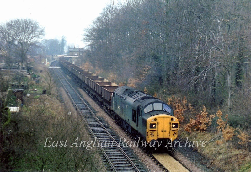 37051 leaves Histon with a Fen Drayton to Kings Cross Yard sand train. 29th January 1980