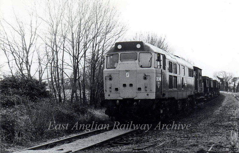 31240 arrives at Oakington with a ballast train.  November 1980.