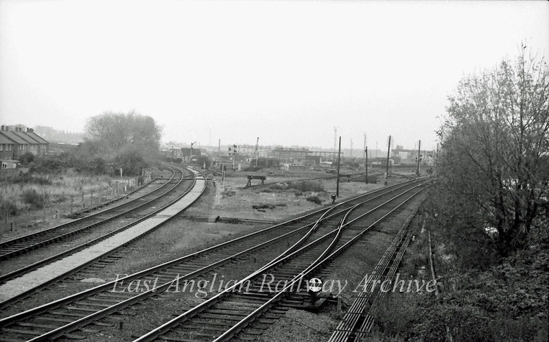 The signalman's view north from Chesterton Junction Signal Box. The line to Ely and Kings Lynn is to the right. The St Ives branch curves in from the left. In the distance 37110 has the clear signal to proceed onto the main line. The area between the two lines is Chesterton permanent way depot. Photo dated November 1980.