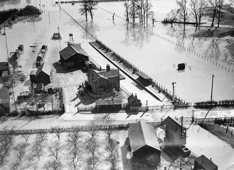 An aerial shot of Swavesey  station during the severe floods of March 1947. There seems to be quite a few wagons around the goods shed and yard.