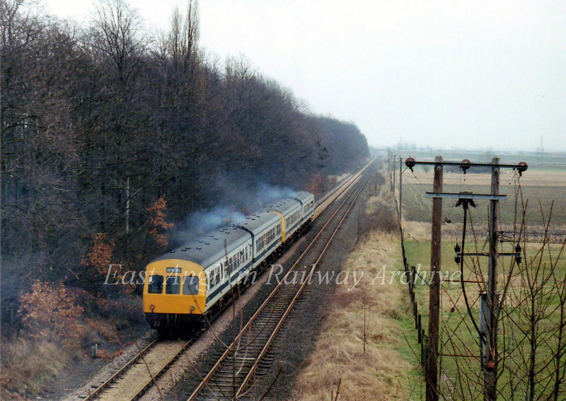 A Railway Development Society special heads towards Cambridge on 31st March 1979.