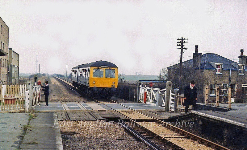 A Railway Correspondence and Travel society  special arrives at Longstanton on 7th May 1979 with Inspector Alec Stanley with the  hat, to the right.