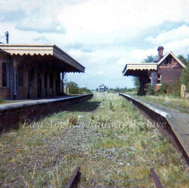 Somersham Station in April 1973. This was a junction station for the line to Ramsey East. In the background is the abandoned junction signal box. In 1982 the station buildings were dismantled and rebuilt at the Fawley Hill Railway at Henley on Thames.