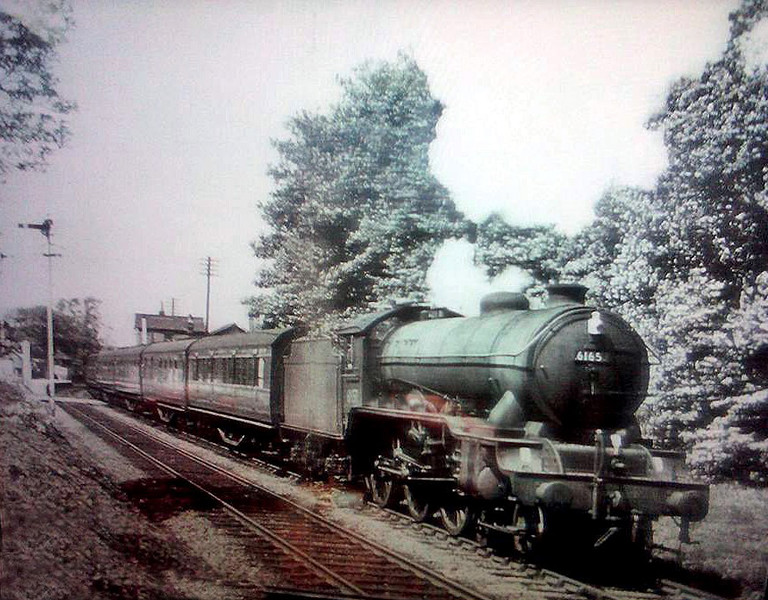 "B17- Sandringham Class 61657 "" Doncaster Rovers "" leaves Histon for Cambridge in May 1960. The loco was withdrawn from service shortly afterwards.  Photo with kind permission of David Runham."