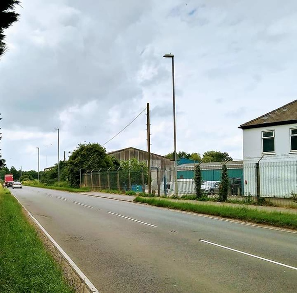 Compared to the previous photo, this is a contemporary view of the same location. The track bed is now the A141 Fenland Way. The only remaining recognisable feature is the building to the extreme right.<br /> <br /> Image:-  Barry Saunders.