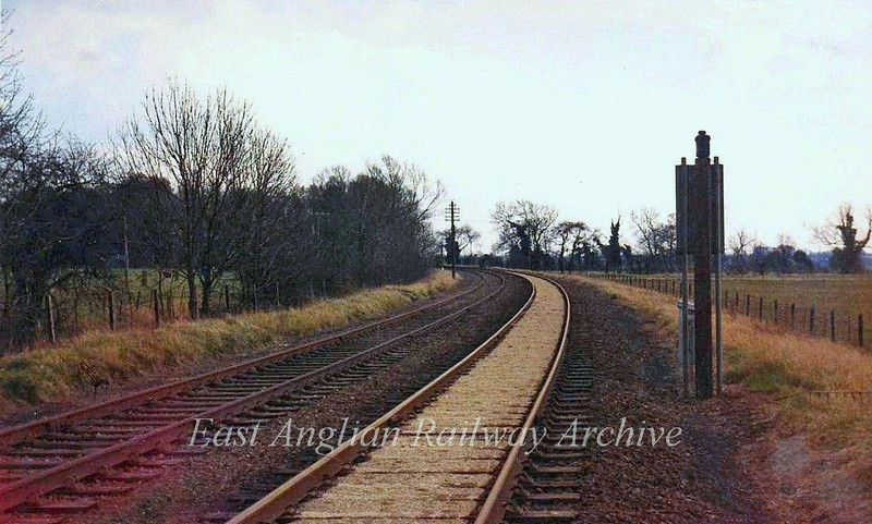 The line looking South East from Oakington Crossing Gates towards Girton Road Crossing and Histon.  March 1974