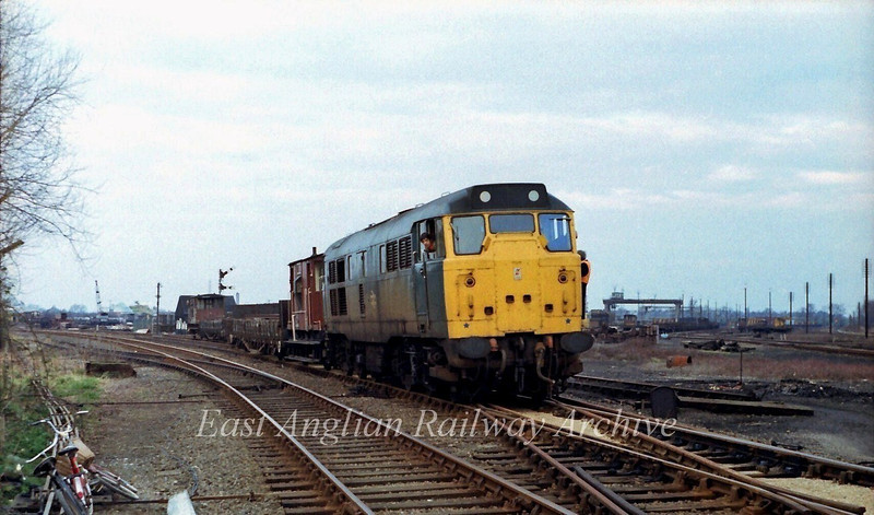 31204 carries out some shunting duties at Chesterton Permanent Way depot.   2nd March 1980.