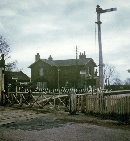 Swavesey on 4th March 1967, the last day of through services to March. Note fluorescent lamps and crossing keepers hut. Photo with kind permission of Stewart Ingram.