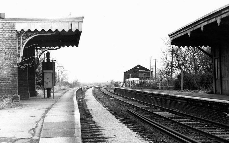 Oakington facing Longstanton from the crossing gates.  18th January 1976.