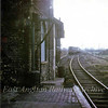 St Ives looking East towards Swavesey from the Kettering branch platform. In the distance Class 31 D5637 is approaching on the main line with a March bound passenger.  4th March 1967. Photo with kind permission of Stewart Ingram.
