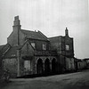 Chatteris. Station forecourt. Image probably taken after closure as the station house appears to be derelict and boarded up.