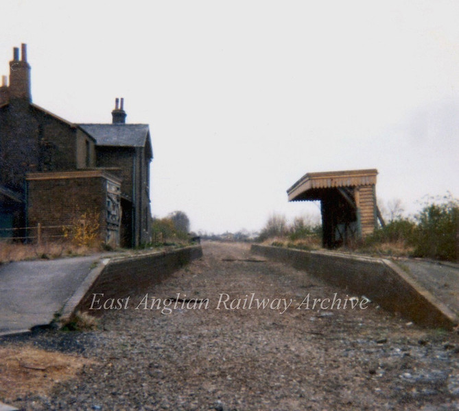 "Wimblington  facing south in April 1973. No trace of the station remains, the A141 road "" Isle of Ely Way"" uses the track bed."