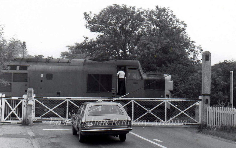 37085 holds up one car on the road to Westwick and Cottenham on the morning of 26th July 1976