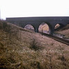 This attractive three arch bridge was located between St Ives and Somersham and carried the road from Bluntisham to Wood Hurst known as Bluntisham Heath Road. The bridge still exists, but is buried underneath tons of landfill. Only part of the top parapet remains.  Photo dated 4th March 1967. With kind permission of Stewart Ingram.
