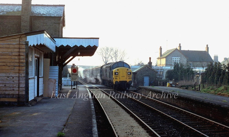 Early morning at Histon. 7am. 37097 eases over the crossing gates with empty coaching stock for a special to Liverpool Street on 12th April 1980. This was probably the first hauled passenger train over this route since 1967.