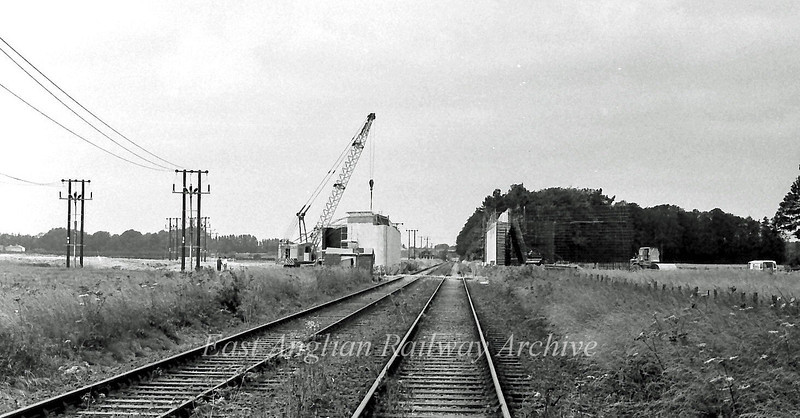 Construction work on the A14 Cambridge Northern Bypass bridge over the St Ives branch.<br /> 10th July 1977