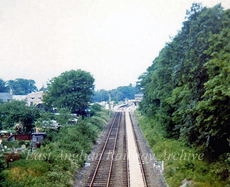 Histon viewed from the bypass bridge showing the location of the Down Home signal post minus it's red signal arm. July 1973. The arm was removed the previous year when the signal box closed.