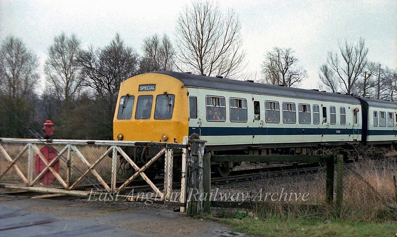 Girton Road crossing  31st March 1979. A Railway Development Society special running from Cambridge to Swavesey waits at the gates. The crossing keepers hut was to the right foreground with a five lever ground frame.