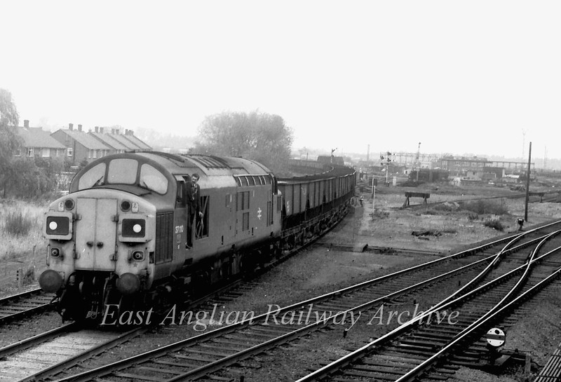 "37110 leaves the St Ives branch at Chesterton Junction, Cambridge. The second man (Pete Pearson) is preparing to give up ""the one engine in steam"" token to the signalman. The working is 8L43 Fen Drayton to Kings Cross Yard.  November 1980"