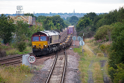 More freight action as DBS 66151 passes by with 4E99 1511 Mossend to Tees Dock Intermodal.  The Edinburgh Suburban lines are predominately used by freight traffic, and even that is much reduced from say ten years ago.  It used to have a passenger service with circular trains calling at some half a dozen stations all now long closed.