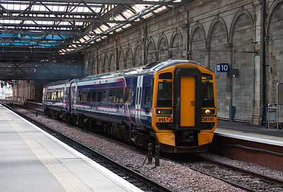 158741 powers up and slips away from platform 10, one of two new platforms to increase the operating ability of Waverley station.  The working is 2P61 1133 Edinburgh to Dunblane.
