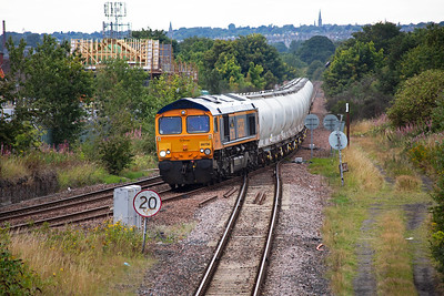 This is Niddrie West Junction on the Edinburgh Suburban line.  66736 wheels over the turnout with 6E45 0807 Fort William to North Blyth empty alumina tanks.  The train is heading for Millerhill Yard and the single line on the foreground runs round to join the ECML at Portobello Junction.  9/9/2015