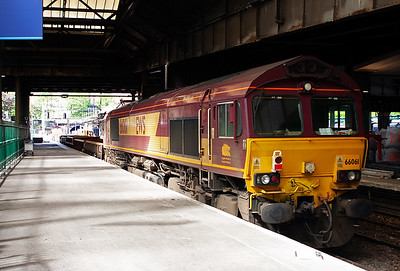 On the other end of the wagons is 66061.