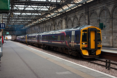 A pair of sprinters in the more usual and familiar ScotRail livery.  158733 and 158711 form 2P69 1503 Edinburgh to Dunblane class 2 service.  The train departs the new platform built on the former Klondyke through siding.
