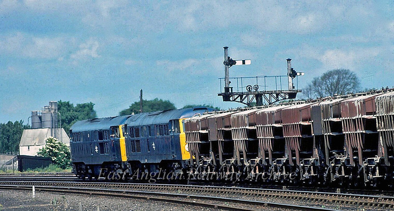 31183/31117 head cement wagons at March South Junction. 21st June 1980.