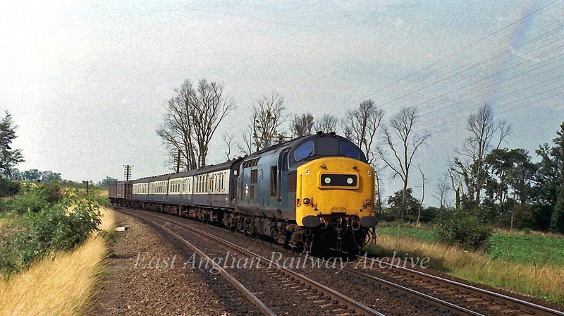 37173 approaches Ely North Junction with a Peterborough to Parkeston Quay working on 4th September 1979.
