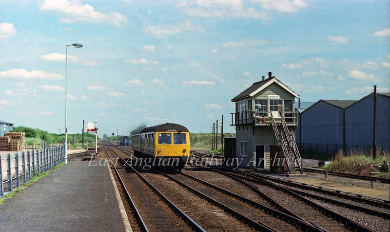 The 1314 Cambridge to Peterborough passes the rather fine signal box at Whittlesey.  19th May 1979.