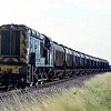 Pilot  08862 heads away from Ely North Junction with grain wagons for the grain silo at Chettisham.  4th September 1979.