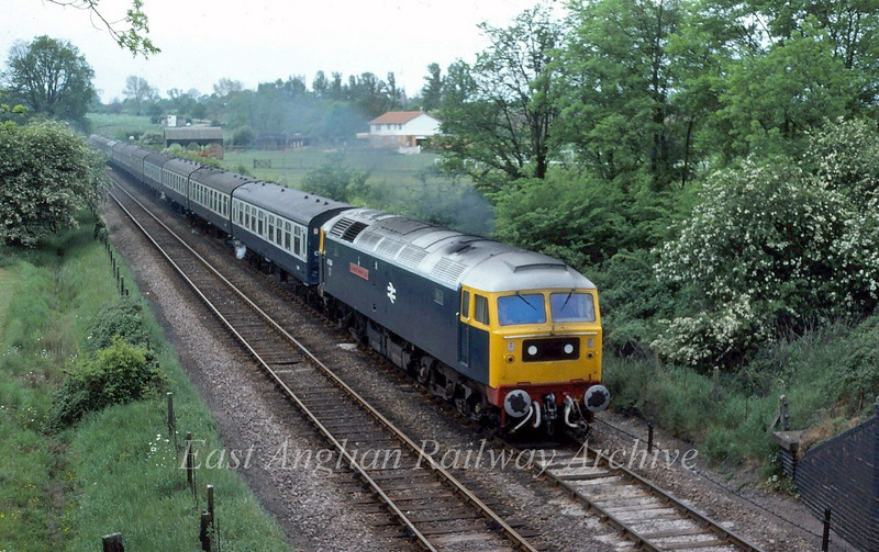 47184, County of Cambridgeshire, heads the 0915 summer Saturdays only Yarmouth to Newcastle on the Ely avoiding loop or West curve on 24th May 1980.