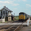 With a backdrop of the flat Cambridgeshire fens 31239 passes the signal box at Manea with the 1240 Parkeston Quay to Peterborough on 18th May 1979.