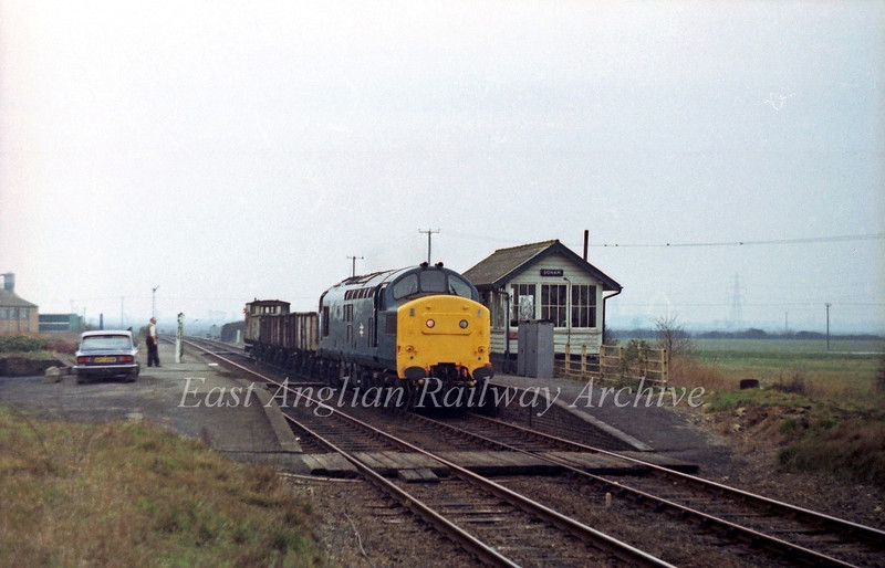 In the days of loose coupled freight. 37219 passes Soham box with the 0950 Bury St Edmunds to Whitemoor goods.  21st February 1980
