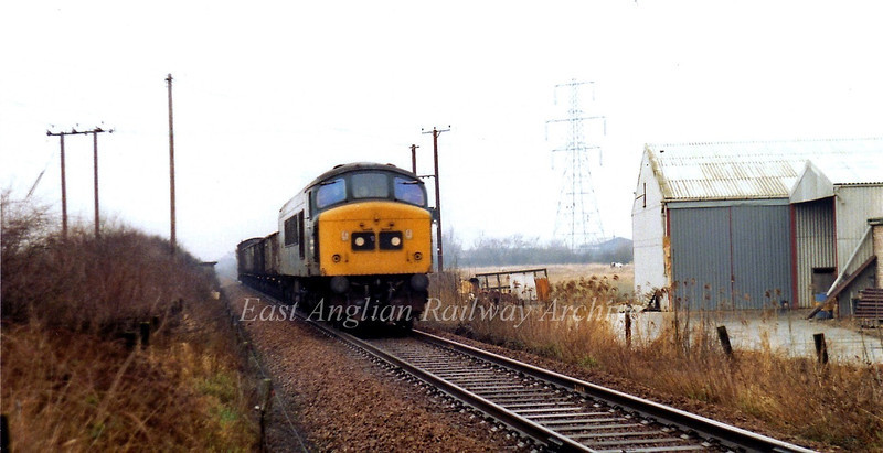 Peak 45077 approaching Soham on the single line section from Ely Dock Junction. 20th January 1980.