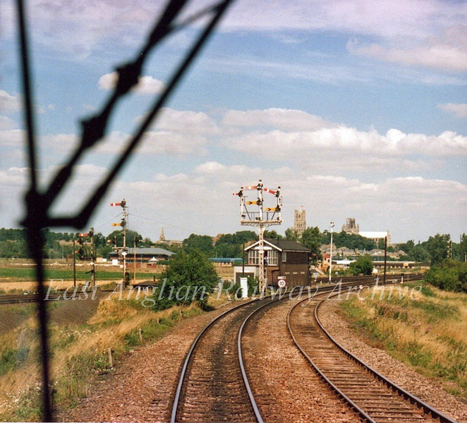 The approach to Ely Dock Junction in the days of semaphores with the ship of the fens (Ely Cathedral) on the skyline. Photo Brian Leighton.