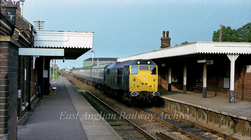 A regular loco hauled working in the late seventies was the Norwich to Birmingham New Street. It was normally hauled by a class 31 and here 31314 races through Wymondham with the 1810 ex Norwich on 22nd July 1978.